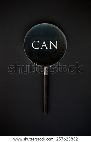 i can and magnifying glass - stock photo