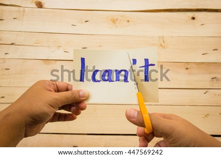 I can self motivation - cutting the letter t of the written word I can't so it says I can - stock photo