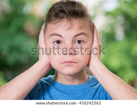 I do not see, do not speak, can not hear anything - outdoor portrait of a teen boy 12-14 year old  - stock photo