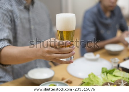 I drink a beer in the diet at home - stock photo