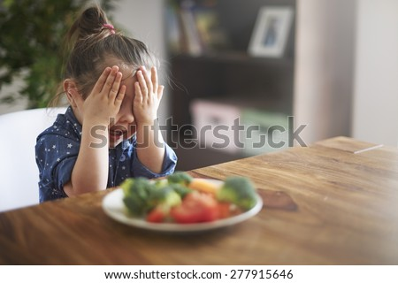 I hate a vegetables! I'm not eating this! - stock photo