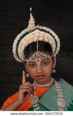 I have one good idea. Pretty Indian girl shows index finger up - stock photo