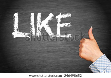 I like it - female hand with thumb up on blackboard background