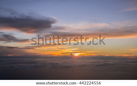 I like to buy the evening air ticket, because at that time can see the sunset above cloud. Most of all it's amazingly beautiful. Not every time can see it, only get the window seat and nice weather. - stock photo