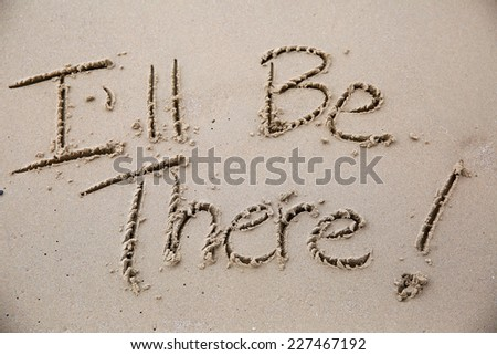 I'll be there, a message written in the sand at the beach.