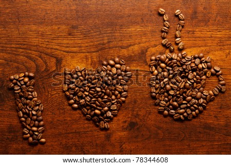 I love coffee inscription on the wooden table - stock photo