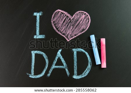 I love dad written on blackboard using chalk - stock photo