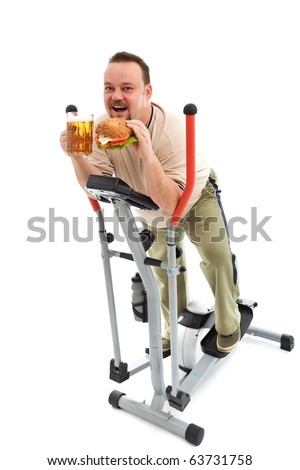 I love exercise - man with large hamburger and beer on exercise equipment - stock photo