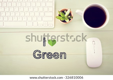 I Love Green concept with workstation on a light green wooden desk - stock photo