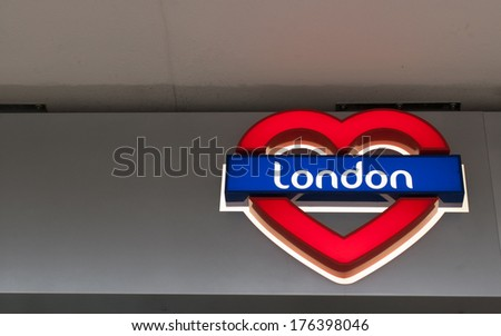 I Love London - Neon sign: London written on a blue  background in a red heart - stock photo
