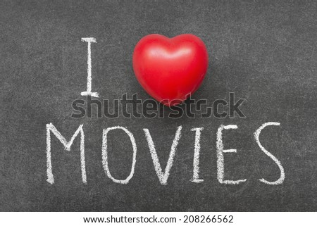 I love MOVIES phrase handwritten on chalkboard with heart symbol instead of O