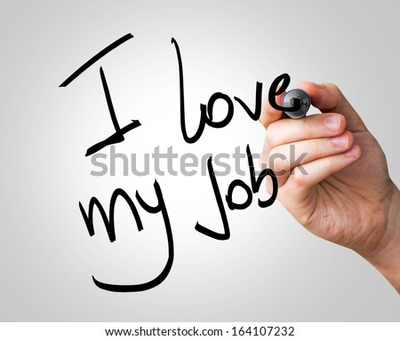 I love my job hand writing with a blue mark on a transparent board - stock photo