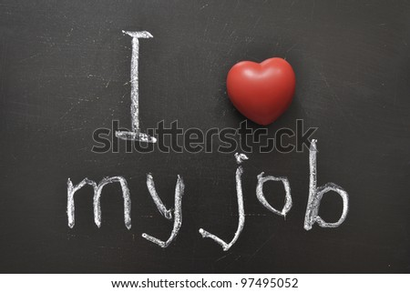 I love my job -  positive concept handwritten on black chalkboard with volume red heart symbol - stock photo