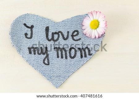 I love my mom written on denim heart. Happy mothers day - stock photo