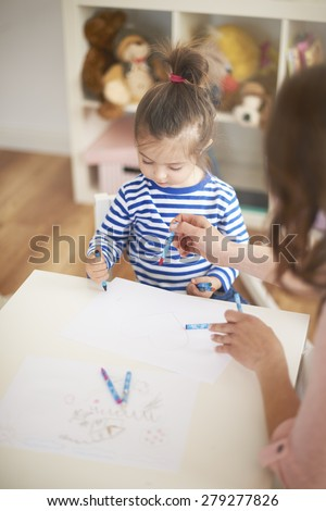 I love painting with my mommy! - stock photo