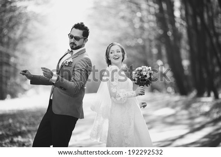 I love you always and forever. Newlywed couple dancing at street. Groom and bride on wedding day. - stock photo