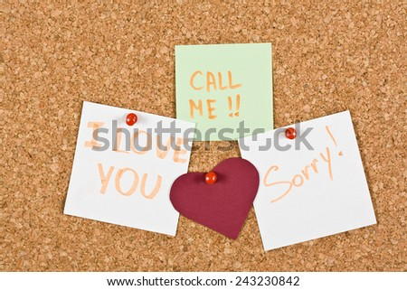 I Love You, call me and sorry note pinned to a cork memory bulletin board. - stock photo