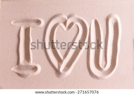 I Love You drawn in golden beach sand with a symbolic heart for romance and love for your sweetheart or Valentine in a simple elegant card design or background - stock photo