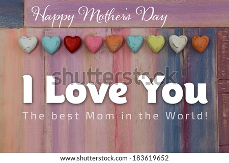 I Love You Happy mothers day message colorful painted board with wooden hearts - stock photo