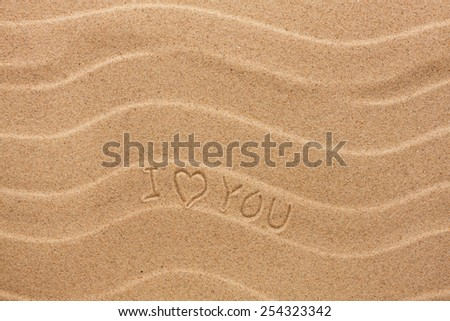 I love you inscription on the wavy sand, as background - stock photo