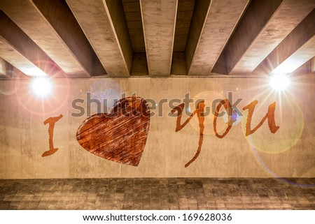 I love you with heart painted as graffiti on the support column of an overpass - stock photo
