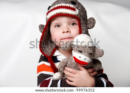 I'm a sock monkey too! 4-year-old with his favorite sock monkey.