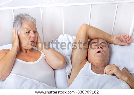 I'm sick of his eternal snoring - stock photo