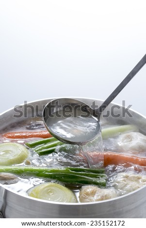 I make chicken broth in a pot, - stock photo