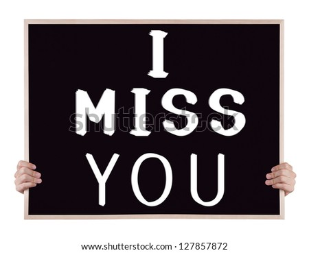 i miss you on blackboard with hands - stock photo