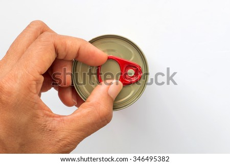 I opening the  can of food on white background, view from the top