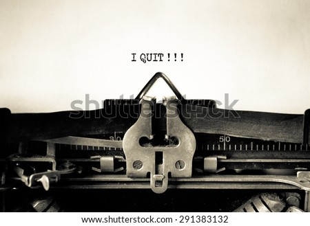 I Quit smoking or Job typed words on a Vintage Typewriter - stock photo