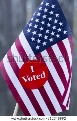I Voted Sticker on small American flag.