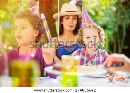 I want another piece of cake. Little girl with chocolate on the mouth - stock photo