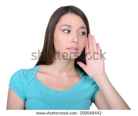 I will keep your secret. Beautiful young woman listening to the gossip while isolated on white - stock photo