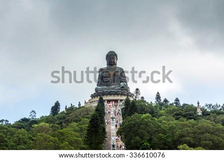 ian Tan Buddha (aka the Big Buddha) is a large bronze statue of a Sakyamuni Buddha and located at Ngong Ping Lantau Island in Hong Kong. - stock photo