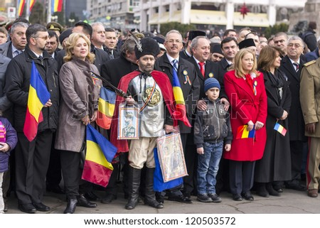 IASI, ROMANIA-DEC. 1: Local politicians attending the National Day of Romania military parade, Union Square, December 1, 2012 in Iasi - stock photo