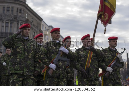 IASI, ROMANIA-DEC. 1: Soldiers marching at the Military Parade on the National Day of Romania, Union Square, December 1, 2012 in Iasi - stock photo