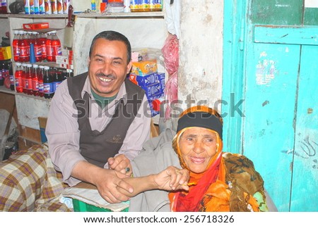 IBB, YEMEN - DECEMBER 2008: unidentified man and woman sell foodstuffs on December 30, 2008 in Ibb.  - stock photo