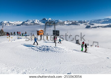 IBERGEREGG, SCHWYZ, SWITZERLAND - FEBRUARY 7: Viem from the hilltop of Mountain Ibergeregg on February 7, 2015. Ibergeregg is a high mountain pass and ski resort in the swiss alps. - stock photo