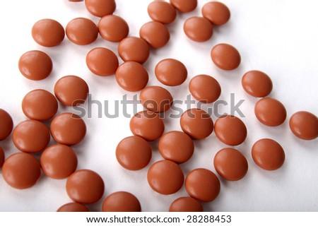 Ibuprofen pills isolated on white - stock photo