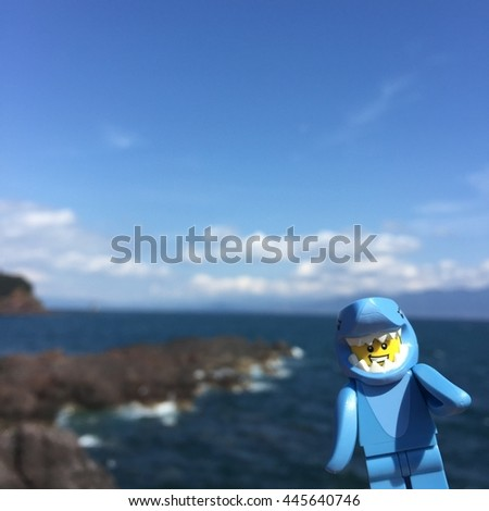 Ibusuki,Japan - March 17,2016 - Lego shark suit guy saying hello from the sea.Lego shark suit guy comes from Lego collectable series 15.Lego is an interlocking brick system collected around the world. - stock photo