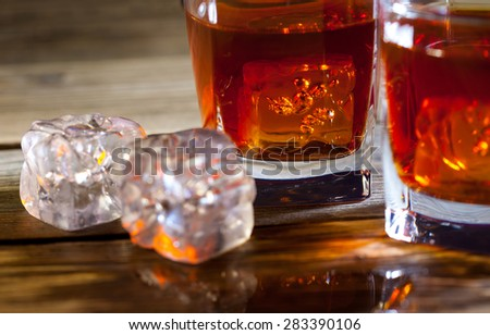ice and whisky, still life on the surface aged table - stock photo