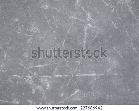 Ice background, skate and hockey ice rink surface texture with scratches - stock photo