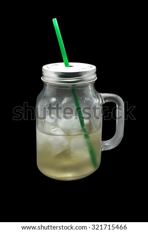 Ice beverage in glass mug with metal lid - stock photo