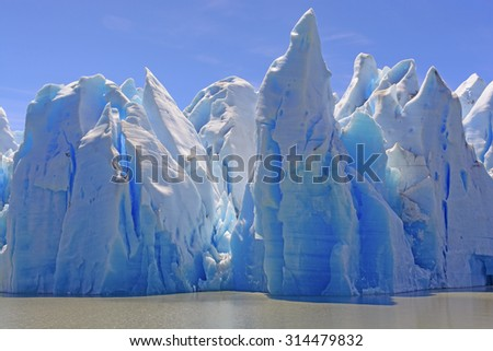 Ice Castles on a Sunny Day at the Grey Glacier in Torres del Paine National Park in Patagonian, Chile - stock photo