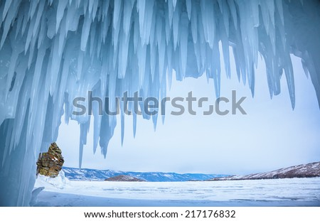 Ice cave near siberian lake Baikal in winter - stock photo