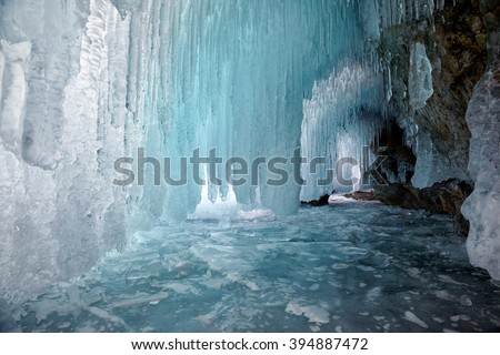 Ice cave on Olkhon island on Baikal lake in Siberia at winter time - stock photo