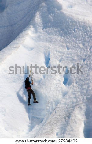 Ice climber with axe on glackier