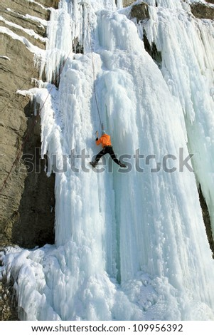 Ice climbing. - stock photo