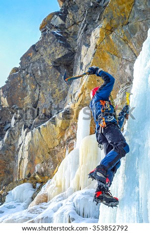 Ice climbing the waterfall - stock photo